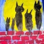 Katzen auf Mauer